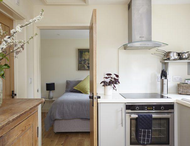 Kitchen looking through to bedroom